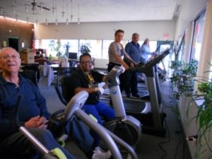 Seniors exercising on treadmills.