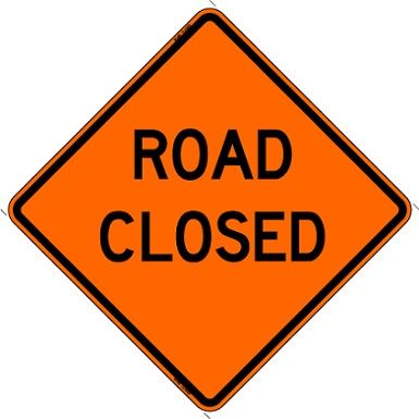 "A construction sign displaying the words ""Road Closed"""